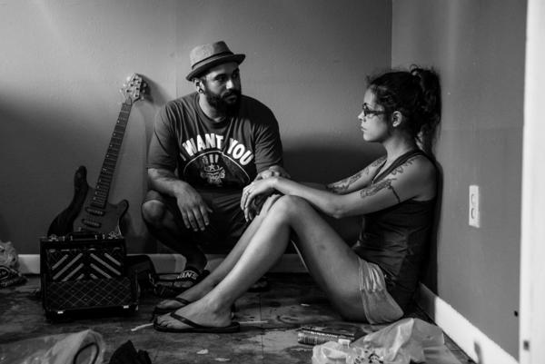"""Wade and Audry sit amongst the dirt and debris left by the flood waters. Having just moved to Baton Rouge from San Antonio, Wade said, """"When you lose everything, it puts what's important into perspective. When we came here, we wanted to start over....Now it looks like we have to."""""""