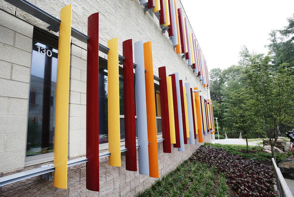 Colored blinds hang outside of a first grade window at the new Sandy Hook Elementary School.