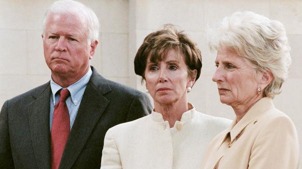Rep. Nancy Pelosi (center), a member of House Speaker Dennis Hastert's working group on terrorism and homeland security, waits to talk to the media on Sept. 11, 2001.