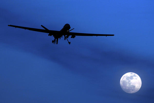 A U.S. Predator drone flies over Kandahar Air Field, southern Afghanistan, on a moonlit night in 2010. The U.S. military has increasingly turned to drones in Syria, Iraq and Afghanistan, where the military carries out airstrikes daily.