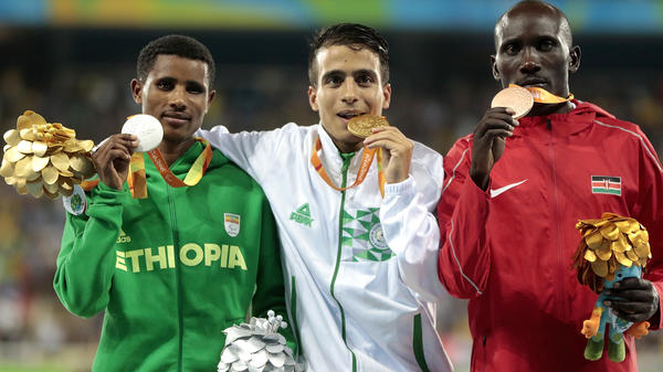 Medalists Tamiru Demisse of Ethiopia (silver), Abdellatif Baka of Algeria (gold) and Henry Kirwa of Kenya (bronze) celebrate after the men's 1500m race in Rio. Their times were all faster than the gold medalist in the same event in the Olympics.