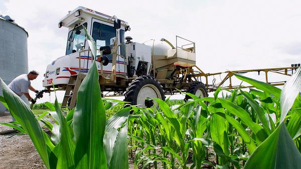 A central Illinois corn farmer refills his sprayer with the weedkiller glyphosate on a farm near Auburn, Ill. The pesticide has been the subject of intense international scrutiny.