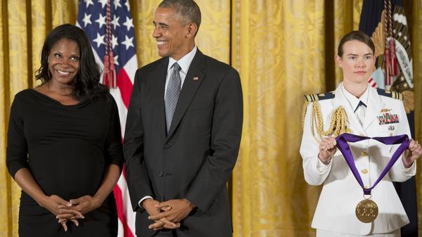 President Obama laughs as he presents actress and singer Audra McDonald with the 2015 National Medal of Arts.