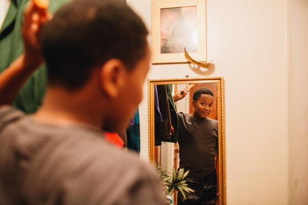 Bryan Bailey combs his hair before heading off to school.