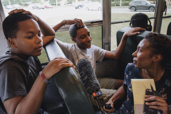Audie Cornish, who was a part of the METCO program when she was a kid, interviews Bryan Bailey and Robert Figueroa as they ride the bus.