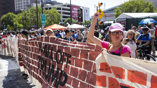 Immigration protesters opposed to Donald Trump's plan to build a new border wall protest in front of Quicken Loans Arena on the third day of the Republican National Convention, July 20, in Cleveland, Ohio.