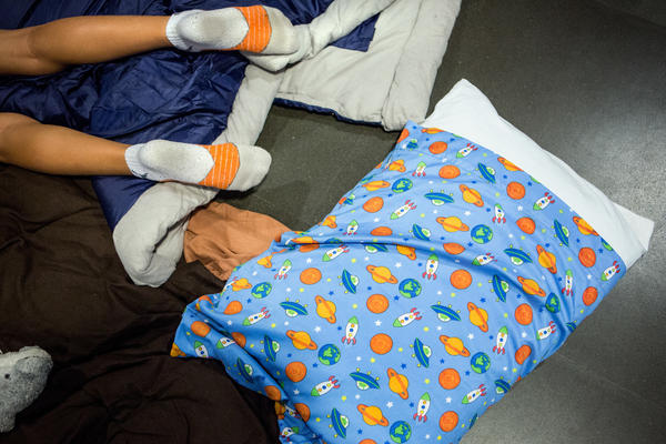Many of the kids brought their space-themed pajamas, sleeping bags, and pillows for the night at the museum.