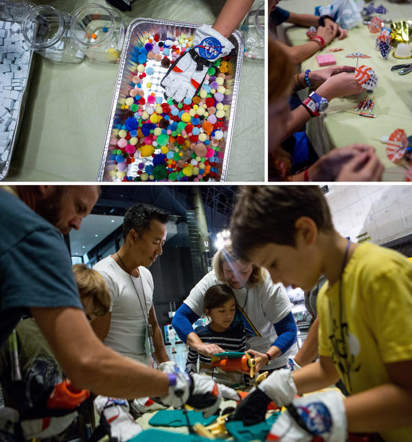 Kids participate in space-themed crafts and exercises, including trying to pick up small objects (top, left) and making their own satellites (top, right). Soraya Okely (bottom, center) gets help building a toy truck while wearing astronaut gloves as kids learn about dexterity in space.