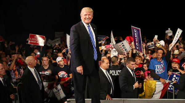 Donald Trump walks off of the stage after speaking at a rally Friday in Michigan.