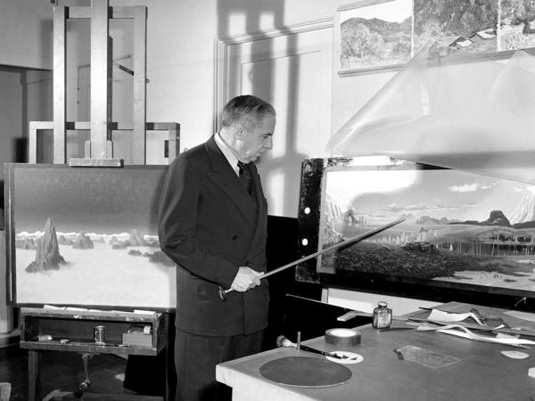 Chesley Bonestell, astronomical artist, points out pyramids on a planet he invented in 1951 for a Hollywood movie.