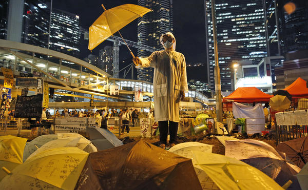 A Hong Kong protester holds an umbrella on Oct. 9, 2014, as part of the weeks of demonstrtions in the city two yeras ago. The protesters opposed the handling of the election for Hong Kong's chief executive, saying the three candidates were all hand-picked by Beijing.