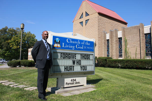 Ennis Tait, the pastor at Cincinnati's Church of the Living God, worries that as an African-American, he wouldn't have a place in Donald Trump's America.