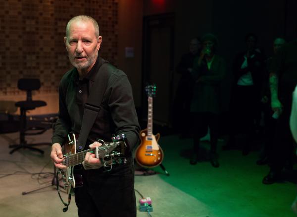 Robert Goldstein plays house guitarist at an NPR staff event in 2015.