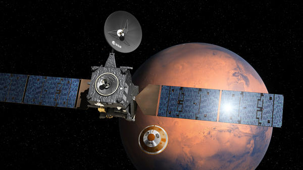 Artist's depiction shows the separation of the Schiaparelli lander from the Trace Gas Orbiter (left) as it heads for the surface of Mars.