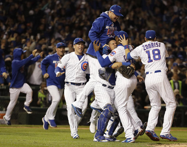Chicago Cubs players celebrate after Game 6 of the National League baseball championship series against the Los Angeles Dodgers, Saturday, in Chicago.