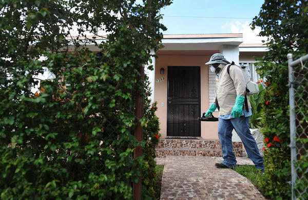 Joseph Blackman, a Miami-Dade County mosquito control inspector, at work in Miami. Mosquitoes infected with Zika are now spreading the illness in at least four different parts of the city, according to federal health officials.