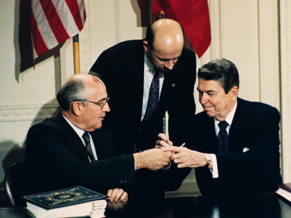 """""""Trust but verify,"""" President Ronald Reagan (right) told Soviet leader Mikhail Gorbachev before they signed the Intermediate Range Nuclear Forces Treaty. Gorbachev's translator, Pavel Palazhchenko, stands in the middle during the signing ceremony on Dec. 8, 1987."""