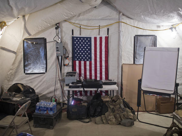 A U.S. flag hangs on the wall of a Qayara command-and-control center at a coalition air base about 30 miles south of Mosul, Iraq.