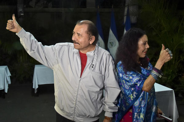 Nicaragua's President Daniel Ortega and his wife, vice presidential candidate Rosario Murillo show their marked thumbs after voting at a polling station near a their home in Managua, Nicaragua, on Sunday.