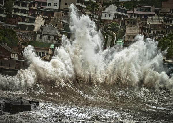 A wave amplified by a typhoon smashes onto the shores of Shengshan, Zhoushan City, China.