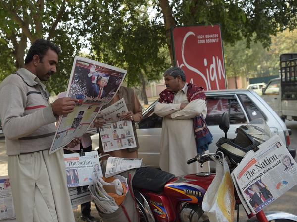 In Islamabad, Pakistanis read local newspapers covering Donald Trump's victory on Thursday.