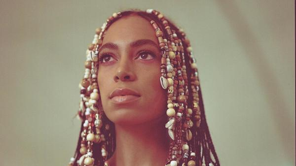 """I'm inviting <em>you</em> to have a seat at <em>my </em>table,"" Solange says. ""And it's an honor to be able to have a seat at our table and for us to open up in this way."""
