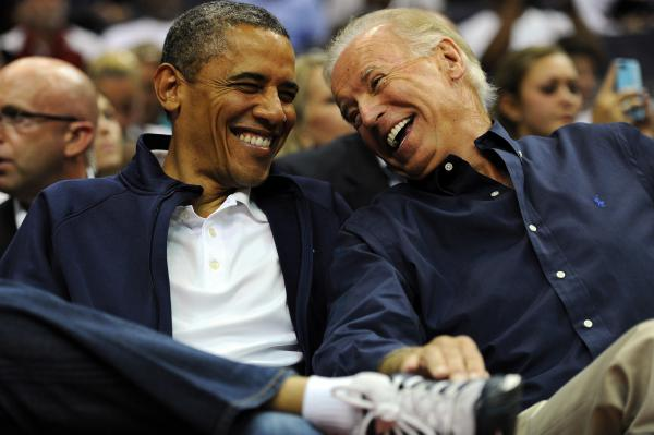 President Obama and Vice President Biden watch a basketball game in July 2012 in Washington, D.C.