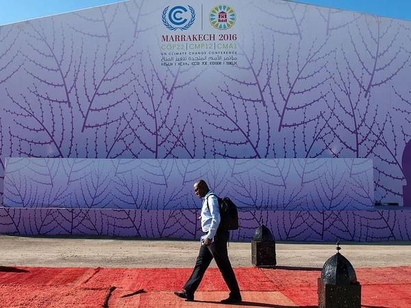 A man walks past the logo of the COP22 international climate conference on Nov. 9 in Marrakech, Morocco.