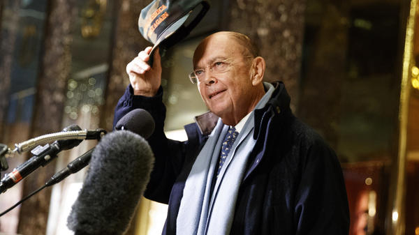 """Wilbur Ross, the president-elect's choice for commerce secretary, tips a """"Make America Great Again"""" cap in the lobby of Trump Tower on Tuesday."""