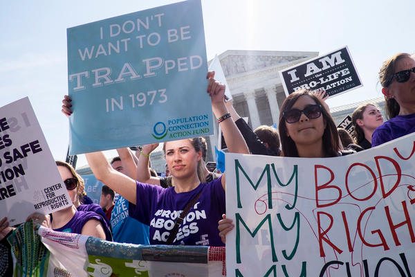 People await a decision outside the Supreme Court on June 27. The court struck down a Texas law restricting abortions.
