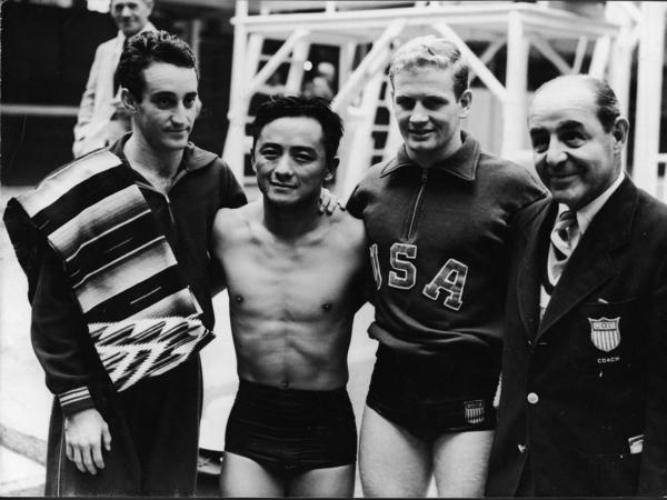 The winners of the 1948 Olympic Men's 10m Platform Diving competition, London, England, August 5, 1948. From left, bronze-medal winner Joaquin Capilla Perez (Mexico), gold medalist Sammy Lee (U.S.), silver medal winner Bruce Ira Harlan (U.S.), and American team coach Mike Peppe.