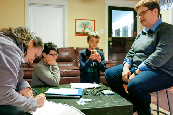 Elisa DiAngelus (left), owner of Delco Mobile Notary, helps Marla and Jennifer (far right) change their child Dylan's gender markers on official documents. Dylan's twin brother, Hayden, looks on.