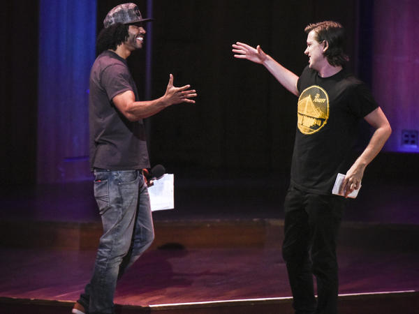Daveed Diggs (left) greets Rafael Casal onstage to emcee the Brave New Voices poetry slam finals at the Kennedy Center on July, 16, 2016 in Washington, DC.