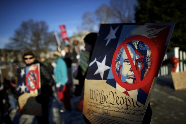 Anti-Donald Trump protesters rally outside the Pennsylvania Capitol Building before electors arrive to cast their votes on Monday in Harrisburg.