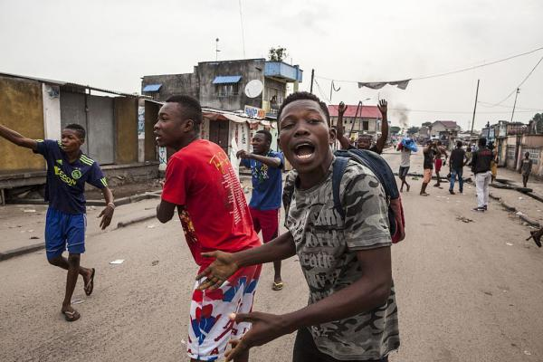 People scream during a protest Tuesday in the neighbourhood of Yolo in Kinshasa, Democratic Republic of Congo.