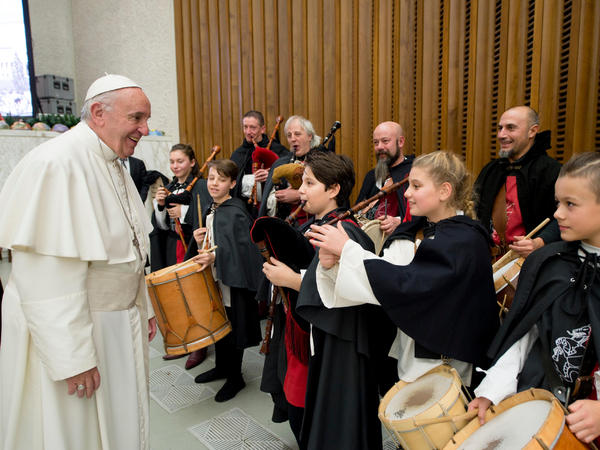 Pope Francis listens to a children's band during his weekly general audience in Paul VI Hall at the Vatican on Dec. 21.