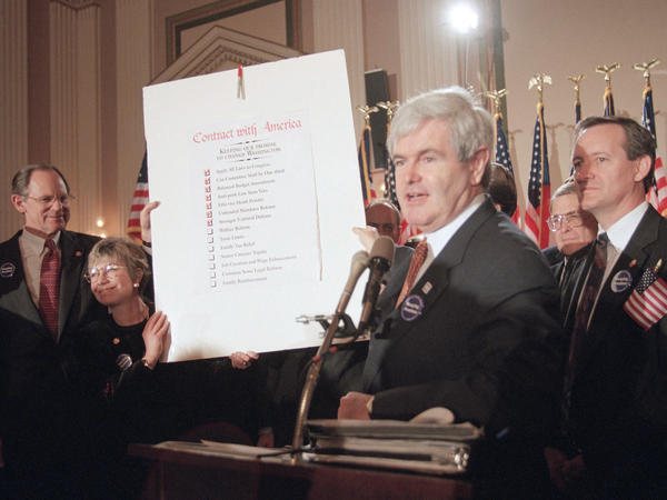 "Then-House Speaker Newt Gingrich holds up a score card during a Republican rally at Capitol Hill in February of 1995. The rally was to mark progress the GOP made on their ""Contract with America"" in the early days of the ""Republican Revolution."""