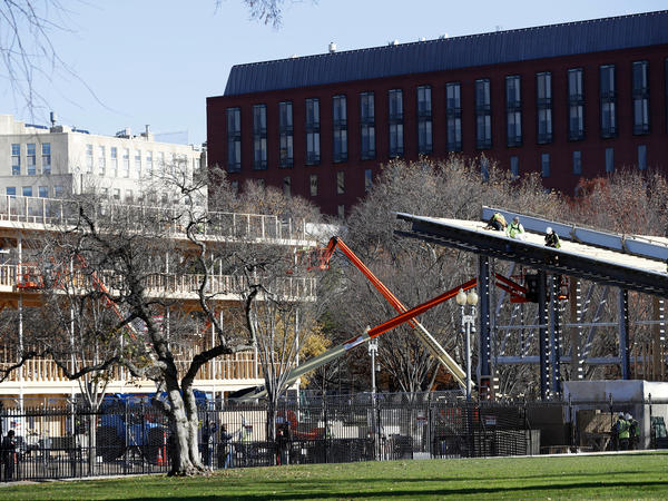 Construction continues on the stands on Pennsylvania Avenue in front of the White House in preparation for the inaugural parade on Jan. 20.