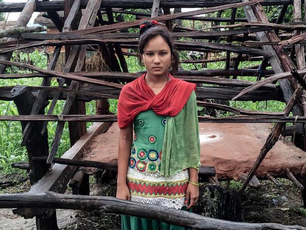 Kamala B.K. in front of her menstruation shed.
