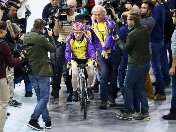 The centenarian was mobbed by members of the media at the velodrome on Wednesday.
