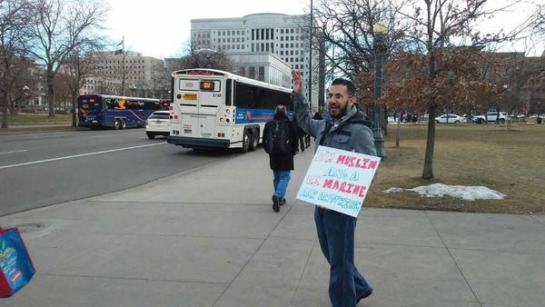 "Mansoor Shams stands in downtown Denver with his sign, ""I'm A Muslim U.S. Marine Ask Anything."" He is traveling the country in an effort to dispel misconceptions about Muslims."