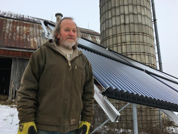 Rick Moore, a dairy farmer in Canton, N.Y., has a solar thermal array to heat water he uses to spray down milking equipment.