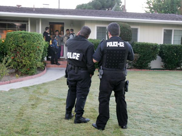 Immigration agents conduct an arrest in Southern California. President Trump's executive order on immigration broadened the category of immigrants whom the government considers a priority for deportation.