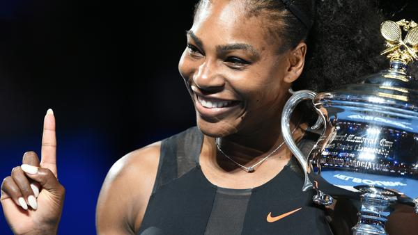 Serena Williams holds the winner's trophy following her victory in the women's singles final in the Australian Open in Melbourne Saturday.