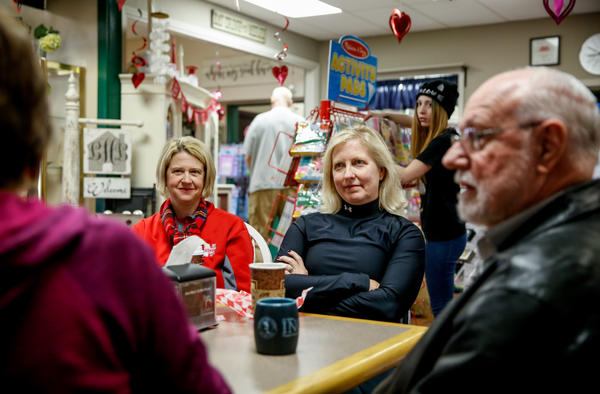 """Sarah Wilson and Kym Kays chat with friends at Ane Mae's coffee shop. """"We do express our opinions, but then we kind of back away politely,"""" says Wilson. """"We are Kansas polite! We are a Kansas polite community!"""" adds Kays."""