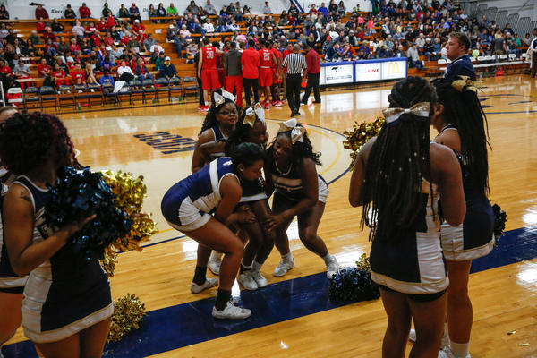 Cheerleaders during a timeout at the Saturday night community college basketball game.
