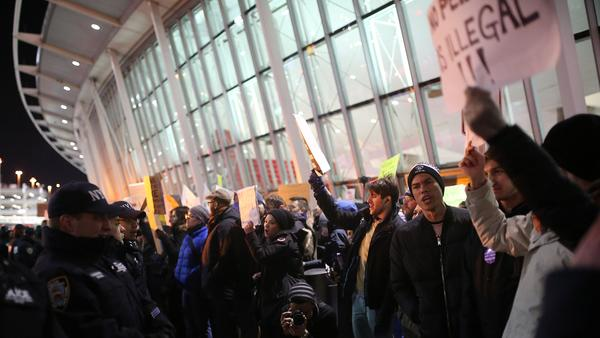 Activists stage a rally at John F. Kennedy International Airport in New York on Saturday against President Trump's order barring travelers from seven Muslim-majority countries for 90 days.