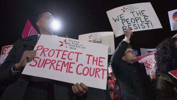 Diallo Brooks, director of outreach and public engagement at People For the American Way, protests President Trump's Supreme Court pick at the steps of the court.
