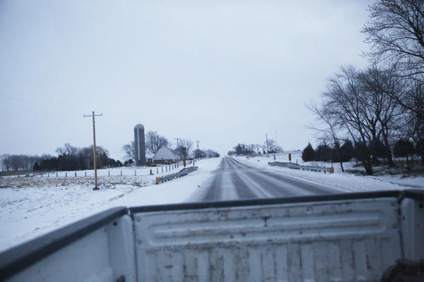 Farms near Independence, Iowa fill the view out the back of Ryan Kress's truck.