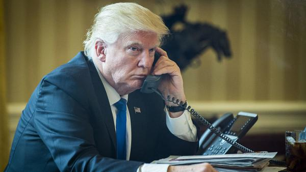 President  Trump speaks on the phone with Vladimir Putin, Russia's president, during the first official phone talks in the Oval Office last Saturday.